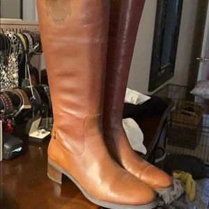 Riding boots color is more Cognac than brown.